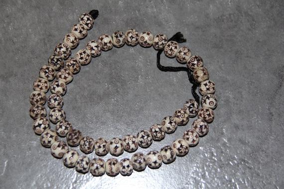 """Buffalo Bone Star Carved Beads, 18"""" long full strand"""