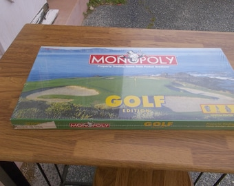 1995 Monopoly golf edition with custom pewter tokens brand new never been open. Made by Parker Brothers. this is the second golf edition.