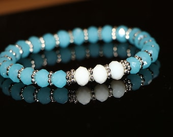 Pretty Blue: Blue and white beaded bracelet with silver accents