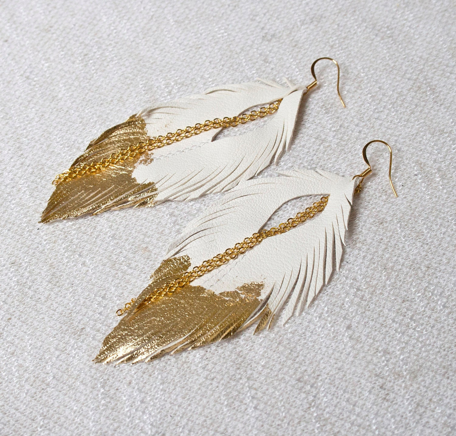 feather c products feathered cle boho earrings