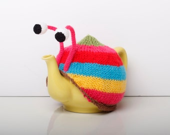 Knitted pink stripy snail tea cosy. Tea lovers teatime treat.