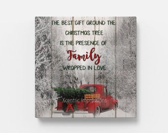 "Red truck with Christmas tree.  12"" x 12"" Canvas Print"