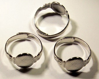 15 pcs. silver tone adjustable ring blanks 8mm pad - f1700