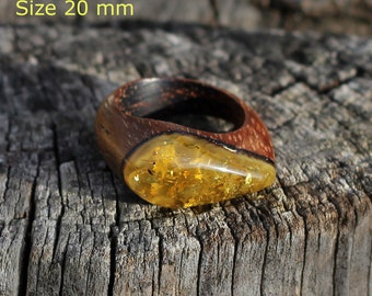 Exclusive handmade ring made from the bog oak and ancient Baltic amber.