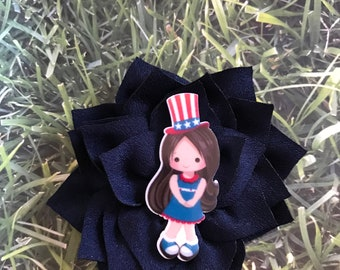 Navy blue flower with a Independence Girl embellishment, on an Alligator Clip.
