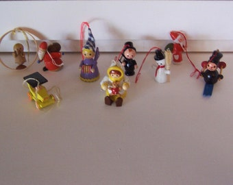 nine wee tiny wooden ornaments