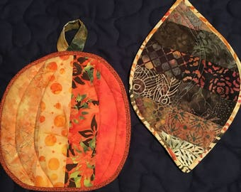 This is a leaf and pumpkin potholder combo.  Front and back photos are both shown here.