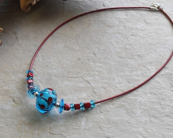 Necklace handmade lampwork hollow beads in blue and red on leather cord