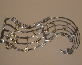 Musical staff metal wall sculpture