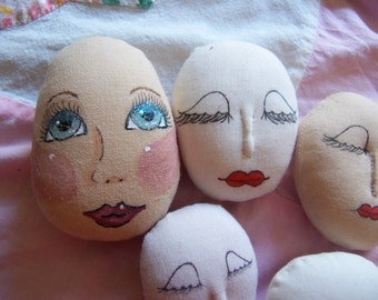 painted fabric doll heads