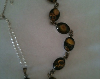 Seashell bracelet and pendant set in sterling silver