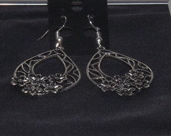 Earrings: Flowers Inc.
