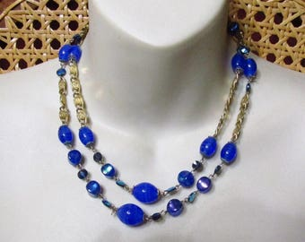 Blue murano glass aurora borealis scroll chain double strand necklace.