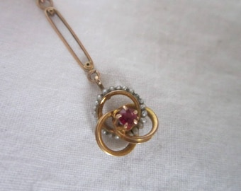 Antique Art Nouveau 10K Solid Yellow Gold Designer OB Necklace Pendant with a Center Ruby and Seed Pearls