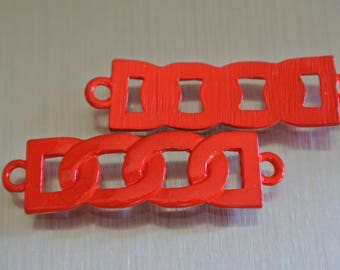 Curbed soldered metal connector stained in red, 42 x 11 mm, slightly curved, two round holes: 2.5 mm.