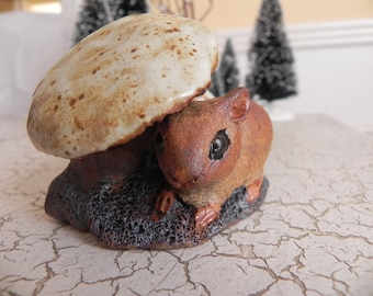 mouse under mushrooms statue in stoneware