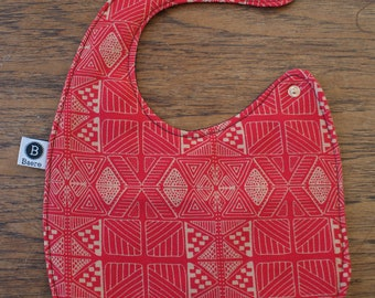 Baby bib with waterproof back red and gold shapes