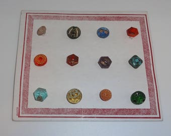 vintage salesman sample card of 12 glass buttons all different shapes & colours