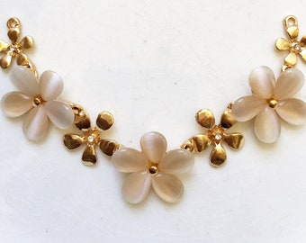salvaged gold tone metal floral design bib necklace component with blushing beige faux opal rhinestones for repurposing