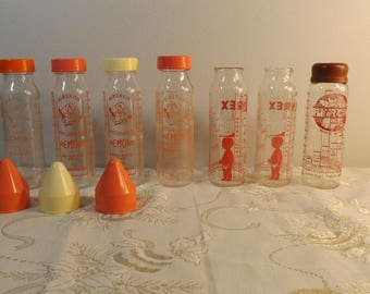 Biberons Remond Pyrex. Old milk Baby bottles. Vintage.