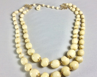 Vintage 1960s ivory acrylic baroque beads gold caps double strand necklace.