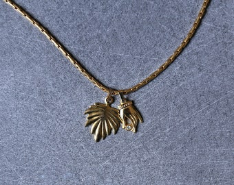 Brass mesh palm leaf and handmade charm necklace