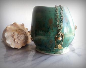 Antique bronze little bird necklace