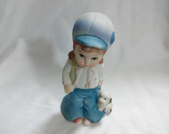 Vintage. Home interior girl and dog figurine. Ceramic. Blue and white.