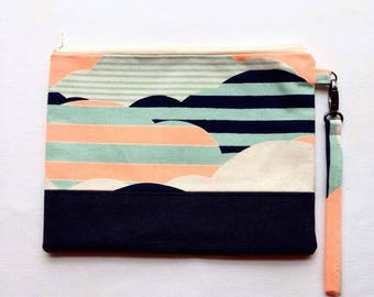 Clutch Purse Handbag with removable wrist strap, zip and 2 slip pockets inside.
