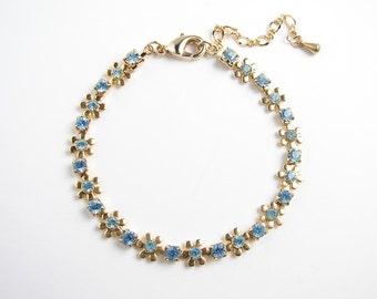 Blue Flower Garland Bracelet. Swarovski Aquamarine Crystal. Gift for Her. Bridesmaid Gift. Simple Modern Jewelry by petitBlue