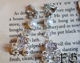 Magic Carriage Clip-on Earrings