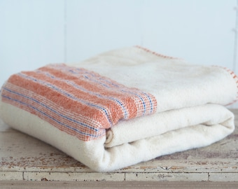 Hand Woven Blanket in a White Cream Color With Orange and Blue Stripes