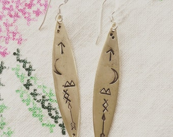 Petroglyph earrings sterling silver and bronze hand stamped earrings
