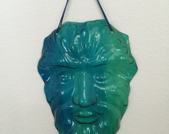Green Man of English Mythology is the symbol of rebirth representing the cyle of growth, slumped glass can be hung inside or in the garden