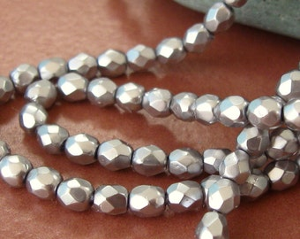 Vintage 3mm Facet Glass Beads in Pearlized Silver.  3 dz.