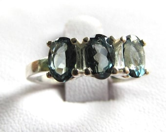 Sterling Silver Three-Stone Ring Set with 6x4mm Forest Green Topaz Oval Gemstones