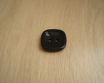 square black button on the back