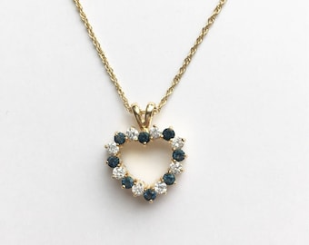 "Double sided blue and clear rhinestone heart pendant and gold tone 17"" chain necklace"