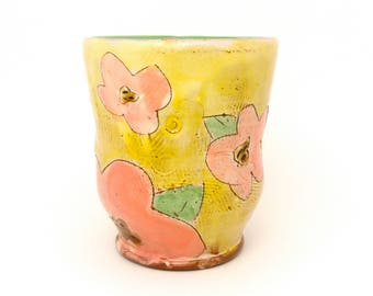 Puffy Floral Earthenware Tumbler. Wheel thrown and altered, food safe cup, made by Kaitlyn Brennan/ Brennan pottery