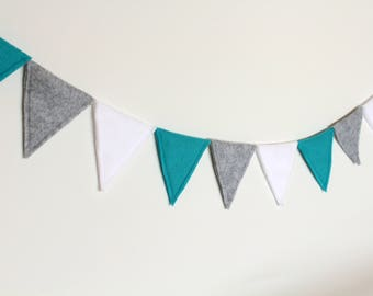 Cheerful flags line of felt, blue, white, grey. a party