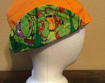 Reversible Orange Ninja Turtle welding cap