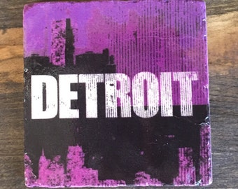 Detroit skyline distressed logo in purple, Coaster with cork backing