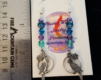 Purple Teal earrings with birds of silver.