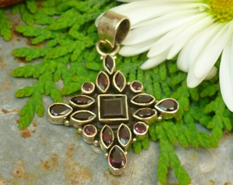 BEAUTIFUL FACETED GARNETS set in 925 sterling silver pendant.