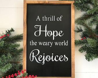 A thrill of hope the weary world rejoices framed sign