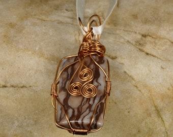 Bronze and copper stone pendant encased in wire