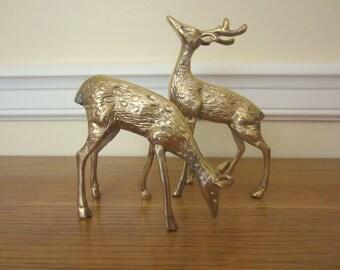 Brass buck and doe.  Brass deer.