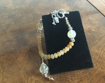 Citrine, and adventurine,  bracelet, toggle close, and perfume bottle charm.