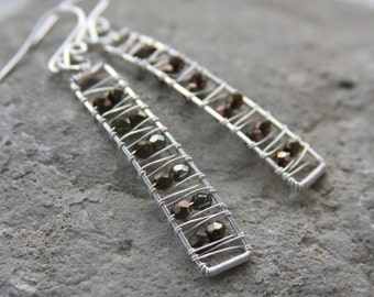 Ladder shaped sculptural wire woven earrings with metallic beads