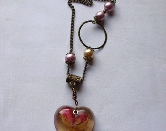 Dried rosebud resin pendant necklace. Powder pink pearls.